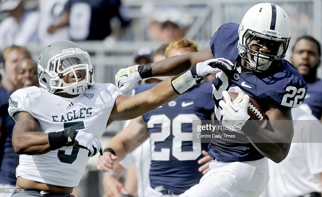 Penn State's Akeel Lynch (22) twists away from Eastern Michigan's Jaleel Canty at Beaver Stadium in University Park, Pennsylvania, on Saturday, September 7, 2013. Penn State overwhelmed the Eagles, 45-7.