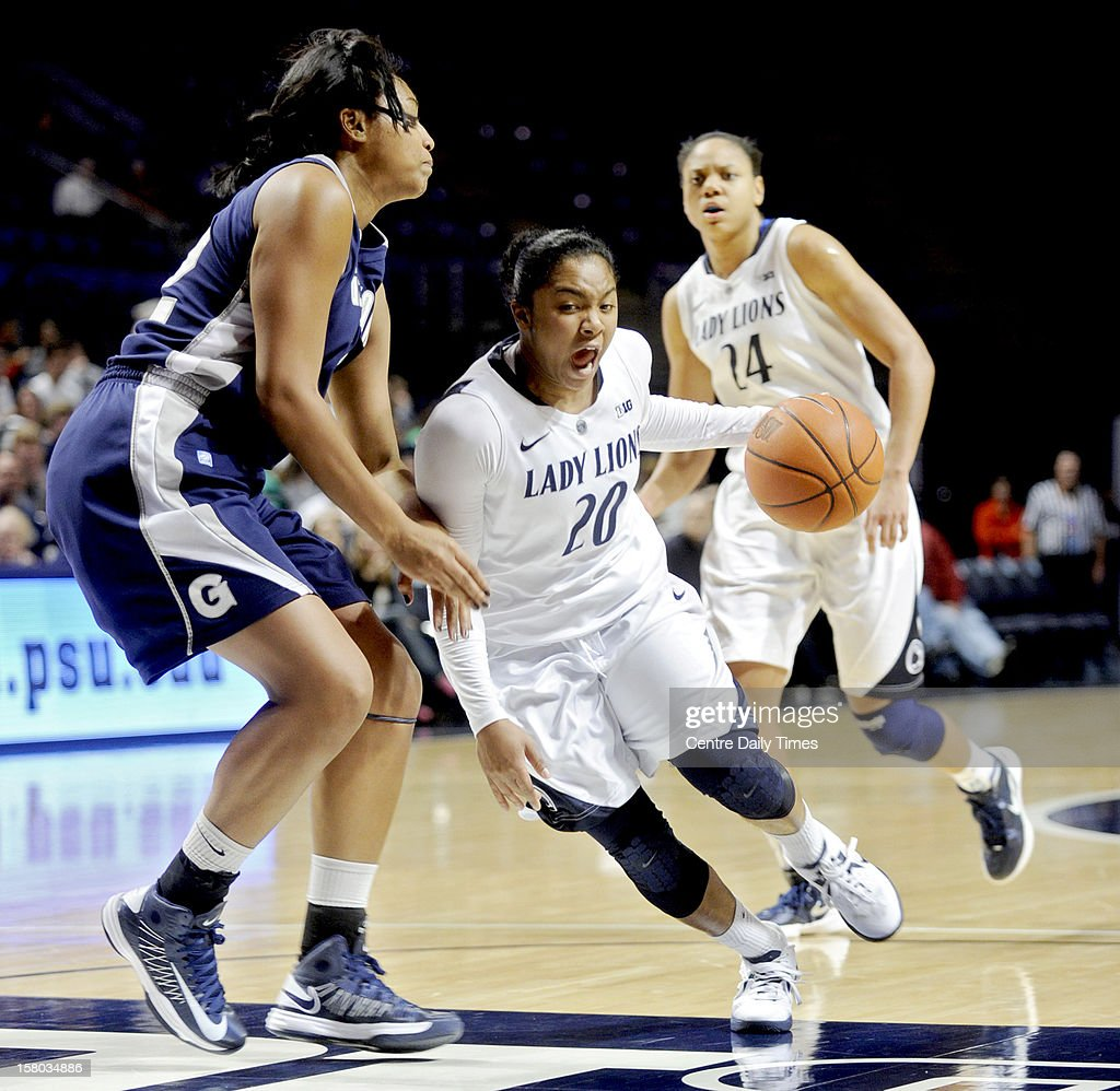 Penn State's Alex Bentley dribbles around Georgetown's Vanessa Moore during a women's college basketball game Sunday, December 9, 2012, at the Bryce Jordan Center in State College, Pennsylvania.