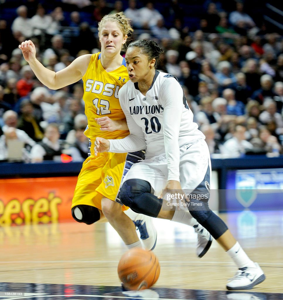 Penn State's Alex Bentley dribbles down the court with the ball around South Dakota State's Tara Heiser during game action at the Bryce Jordan Center in State College, Pennsylvania, Sunday, December 16, 2012. Penn State beat South Dakota State, 60-50.