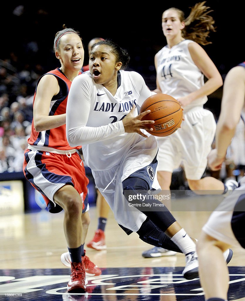 Penn State's Alex Bentley drives to the basket past NJIT's Kim Tullis during a women's college basketball game at the Bryce Jordan Center on Sunday, December 23, 2012, in State College, Pennsylvania.