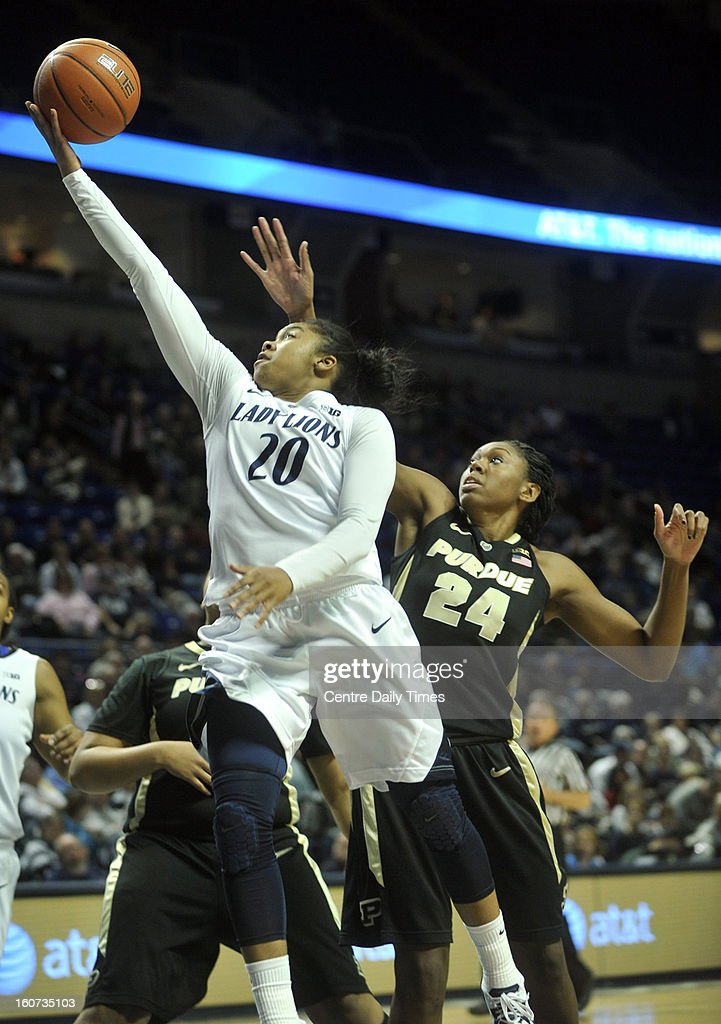 Penn State's Alex Bentley scores on a layup against Purdue's Drey Mingo during a women's college basketball game in State College, Pennsylvania, Monday, February 4, 2013.