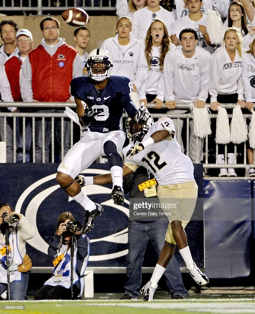 Penn State's Allen Robinson bobbles the catch, but Central Florida's Jacoby Glenn (12) draws an interference call on Saturday, September 14, 2013, at Beaver Stadium in University Park, Pennsylvania. UCF prevailed, 34-31.