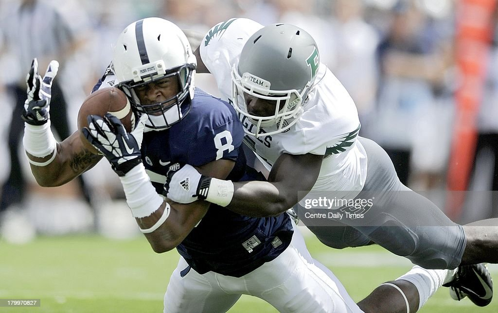 Penn State's Allen Robinson (8) makes a catch for a first down against Eastern Michigan's Willie Creear III during the first quarter at Beaver Stadium in University Park, Pennsylvania, on Saturday, September 7, 2013. Penn State overwhelmed the Eagles, 45-7.