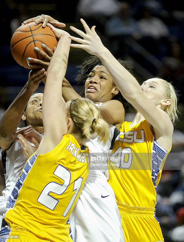 Penn State's Ariel Edwards, center, battles for the ball with South Dakota State's Leah Dietel and Mariah Clarin during game action at the Bryce Jordan Center in State College, Pennsylvania, Sunday, December 16, 2012. Penn State beat South Dakota State, 60-50.