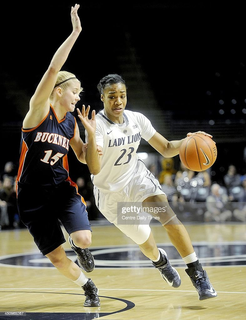Penn State's Ariel Edwards dribbles down the court with the ball around Bucknell's Shelby Romine in State College, Pa., on Wednesday, Nov. 20, 2013. The Nittany Lions defeated the Bison, 92-49.