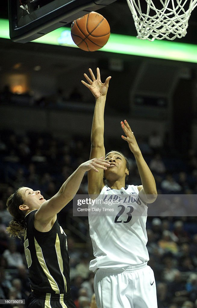 Penn State's Ariel Edwards puts up a shot against Purdue's Courtney Moses during a women's college basketball game in State College, Pennsylvania, Monday, February 4, 2013.
