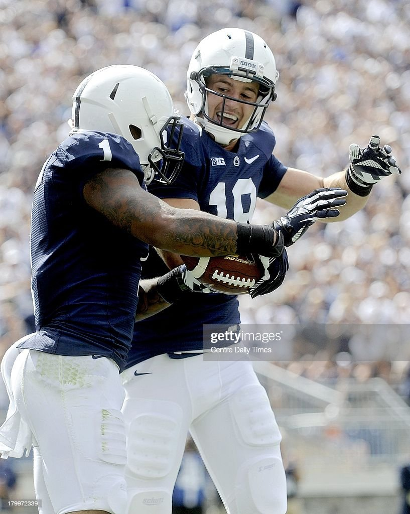 Penn State's Bill Belton and Jesse James celebrate one of Belton's two touchdown runs against Eastern Michigan at Beaver Stadium in University Park, Pennsylvania, on Saturday, September 7, 2013. Penn State overwhelmed the Eagles, 45-7.