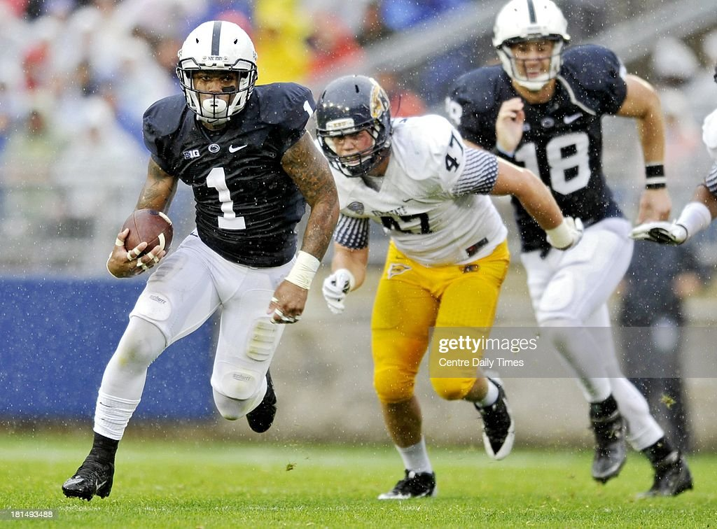 Penn State's Bill Belton runs down field with the ball past Kent State defenders during a college football game at Beaver Stadium in State College, Pennsylvania, on Saturday, September 21, 2013.