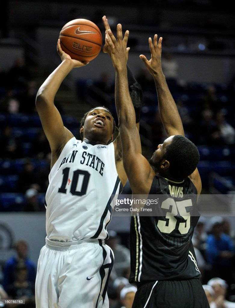 Penn State's Brandon Taylor puts a shot up against Purdue's Rapheal Davis in State College, Pennsylvania, Tuesday, February 5, 2013.
