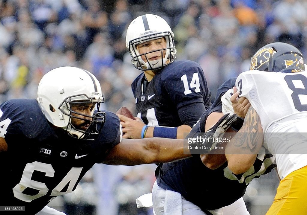 Penn State's Christian Hackenberg looks for an open receiver as Penn State's John Urschel blocks Kent State defenders at Beaver Stadium in State College, Pennsylvania, on Saturday, September 21, 2013.