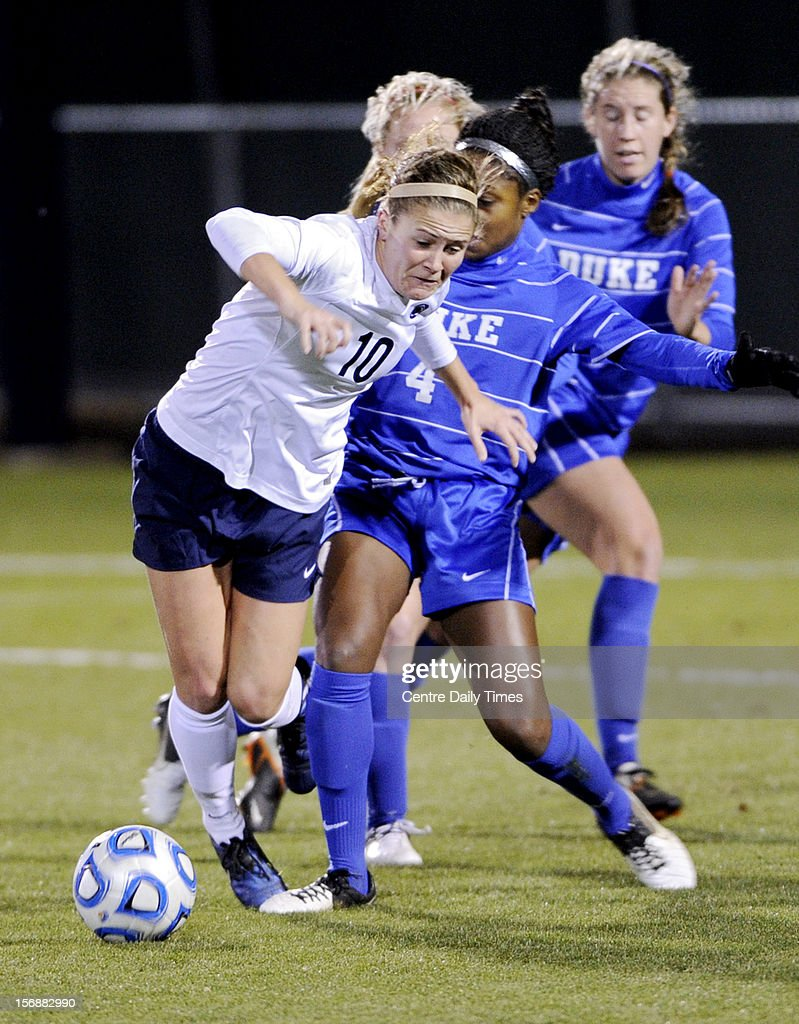Penn State's Christine Nairn, left, is fouled by Duke's Natasha Anasi in the quarterfinals of the NCAA championships on Friday, November 23, 2012, at Jeffrey Field in University Park, Pennsylvania. Nairn's resulting pentalty kick was the only goal of the game in a 1-0 Penn State win.
