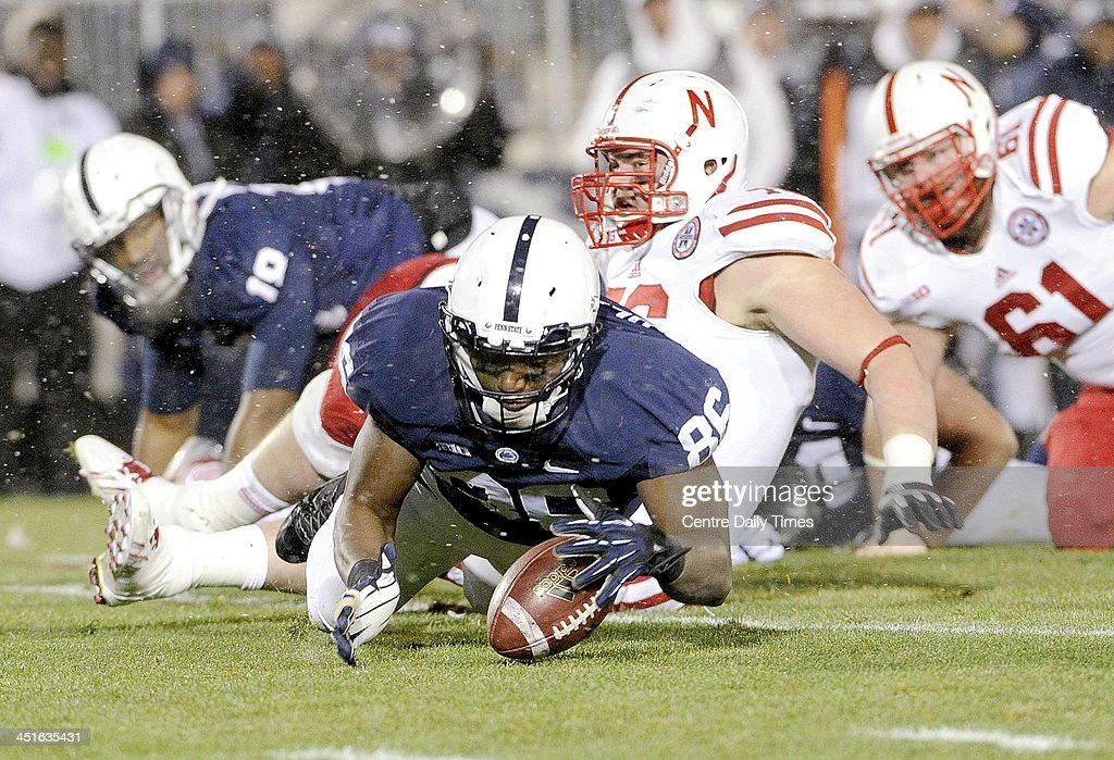 Penn State's C.J. Olaniyan dives on the ball after it was fumbled by Nebraska at Beaver Stadium in University Park, Pa., on Saturday, Nov. 23, 2013. Nebraska won, 23-20.