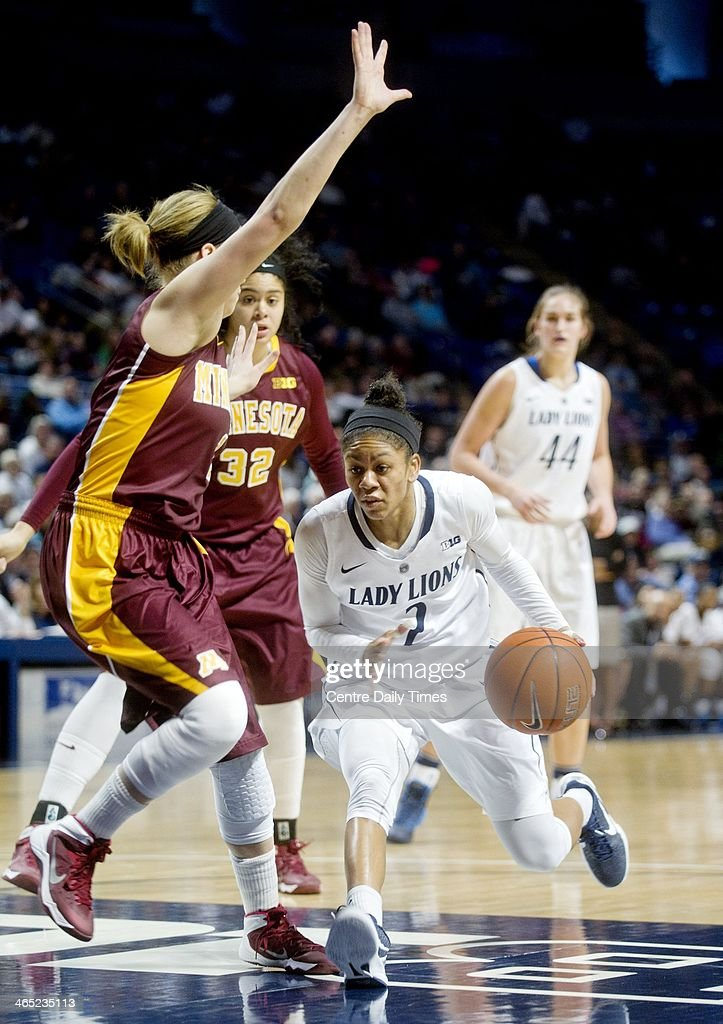 Penn State's Dara Taylor dribbles around Minnesota's Rachel Banham during a women's college basketball game at the Bryce Jordan Center in State College, Pa., on Sunday, Jan. 26, 2014. The Penn State Lady Lions defeated the Minnesota Gophers, 83-53.
