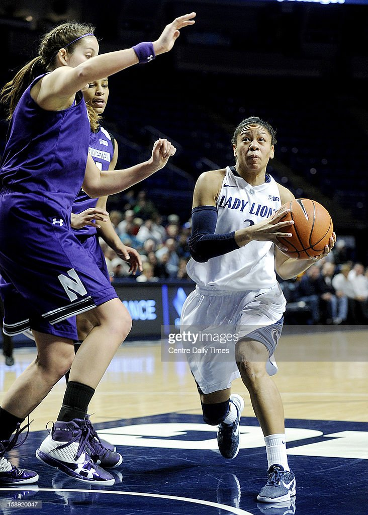 Penn State's Dara Taylor, right, drives the lane against the Northwestern defense at Bryce Jordan Center in University Park, Pennsylvania, on Thursday, January 3, 2013. The Lady Lions defeated Northwestern, 73-69.