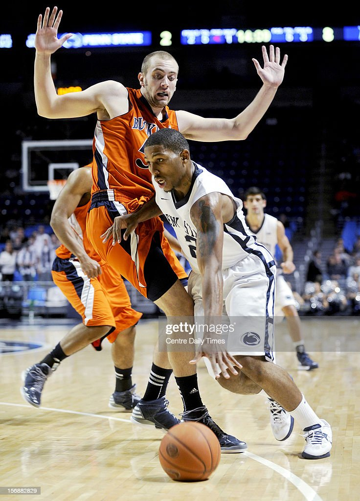 Penn State's D.J. Newbill dribbles around Bucknell's Dom Hoffman on Friday, November 23, 2012, at the Bryce Jordan Centerin University Park, Pennsylvania. Penn State prevailed, 60-57.