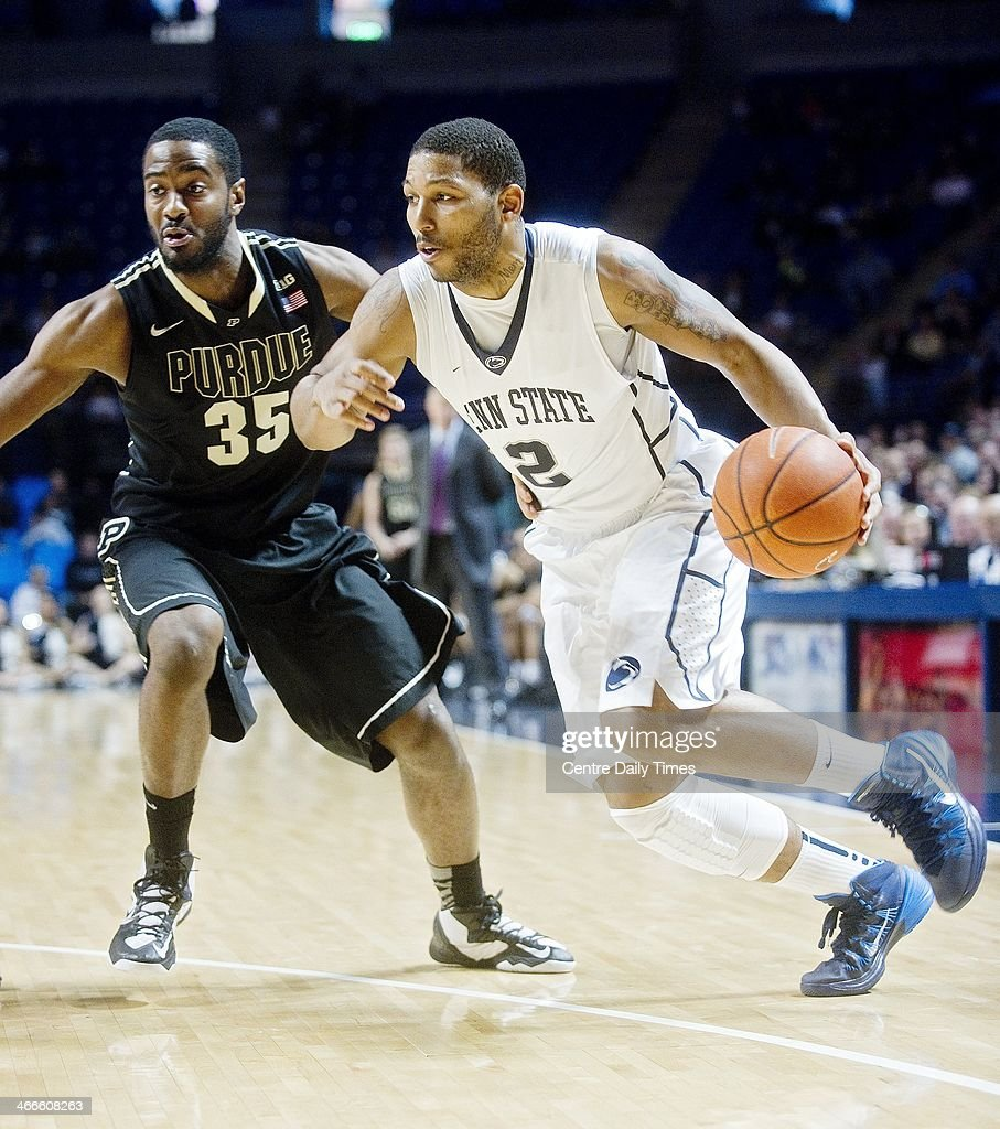 Penn State's D.J. Newbill dribbles around Purdue's Rapheal Davis on Sunday, Feb. 2, 2014, at the Bryce Jordan Center in State College, Pa. The Nittany Lions defeated the Boilermakers, 79-68.