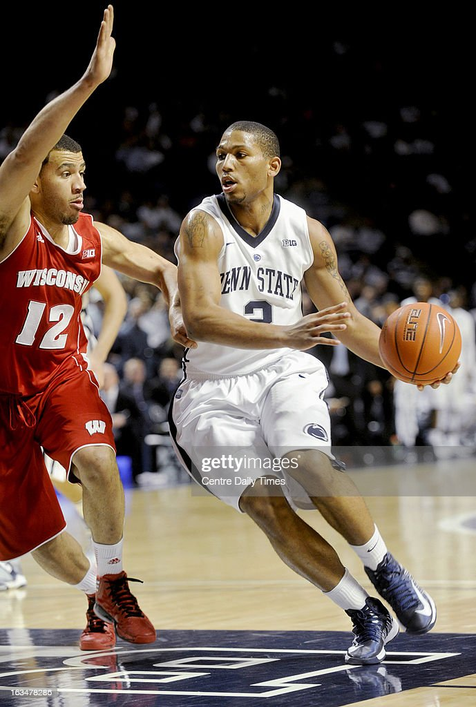 Penn State's D.J. Newbill dribbles around Wisconsin's Traevon Jackson during a men's college basketball game at the Bryce Jordan Center in State College, Pennsylvania, Sunday, March 10, 2013.
