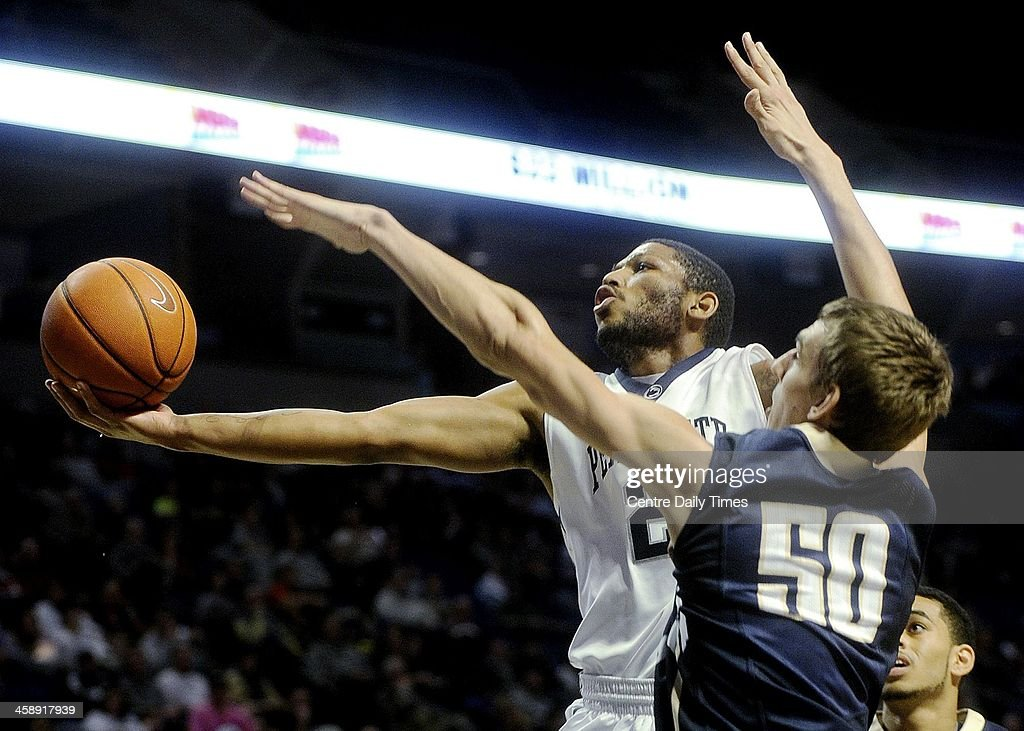 Penn State's D.J. Newbill goes in for a basket past Mount St. Mary's Taylor Danaher during game action at the Bryce Jordan Center in State College, Pa., Sunday, Dec. 22, 2013. Penn State beat Mount St. Mary's, 92-82.