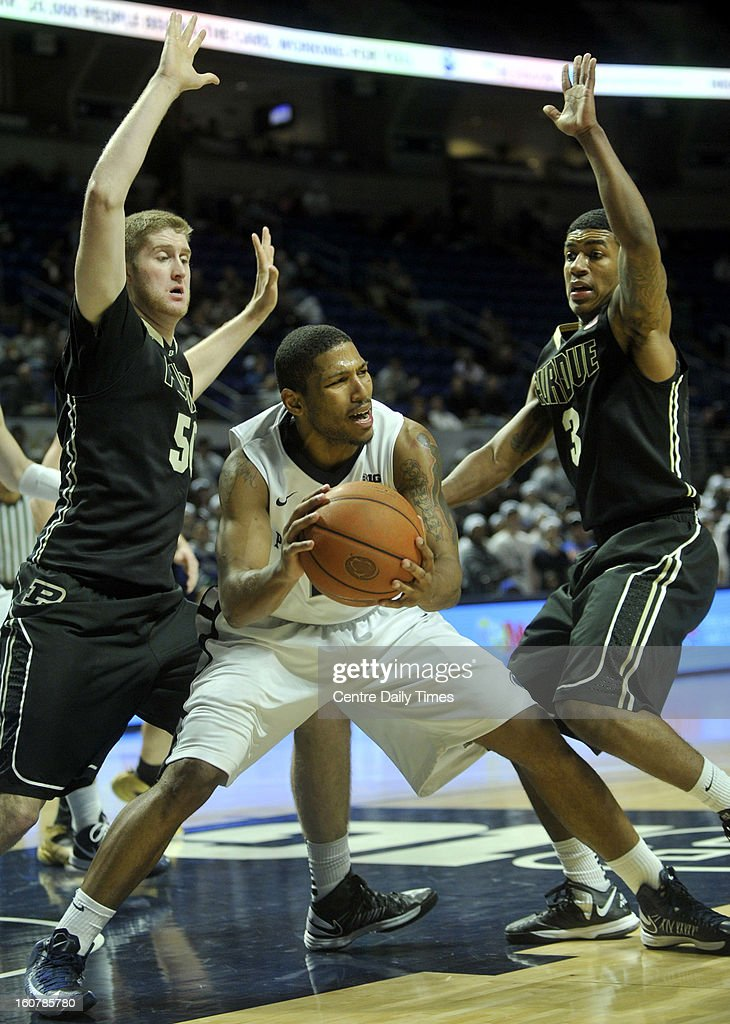 Penn State's D.J. Newbill is trapped by Purdue's Travis Carroll, left, and Ronnie Johnson in State College, Pennsylvania, Tuesday, February 5, 2013.