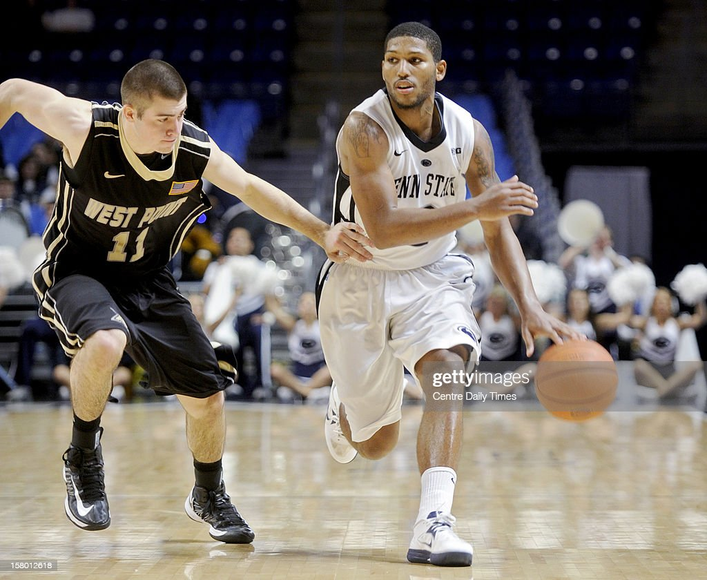 Penn State's D.J. Newbill, right, dribbles under pressure from Army's Dylan Cox on Saturday, December 8, 2012, at the Bryce Jordan Center in University Park, Pennsylvania. Penn State topped Army, 78-70.
