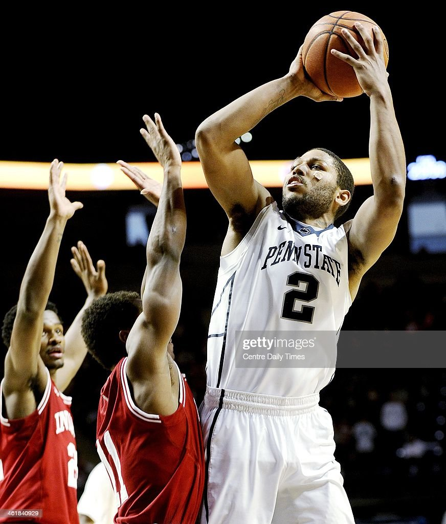 Penn State's D.J. Newbill (2) shoots over Indiana defenders on Saturday, Jan. 11, 2014, at the Bryce Jordan Center in University Park, Pa. Indiana won, 79-76.
