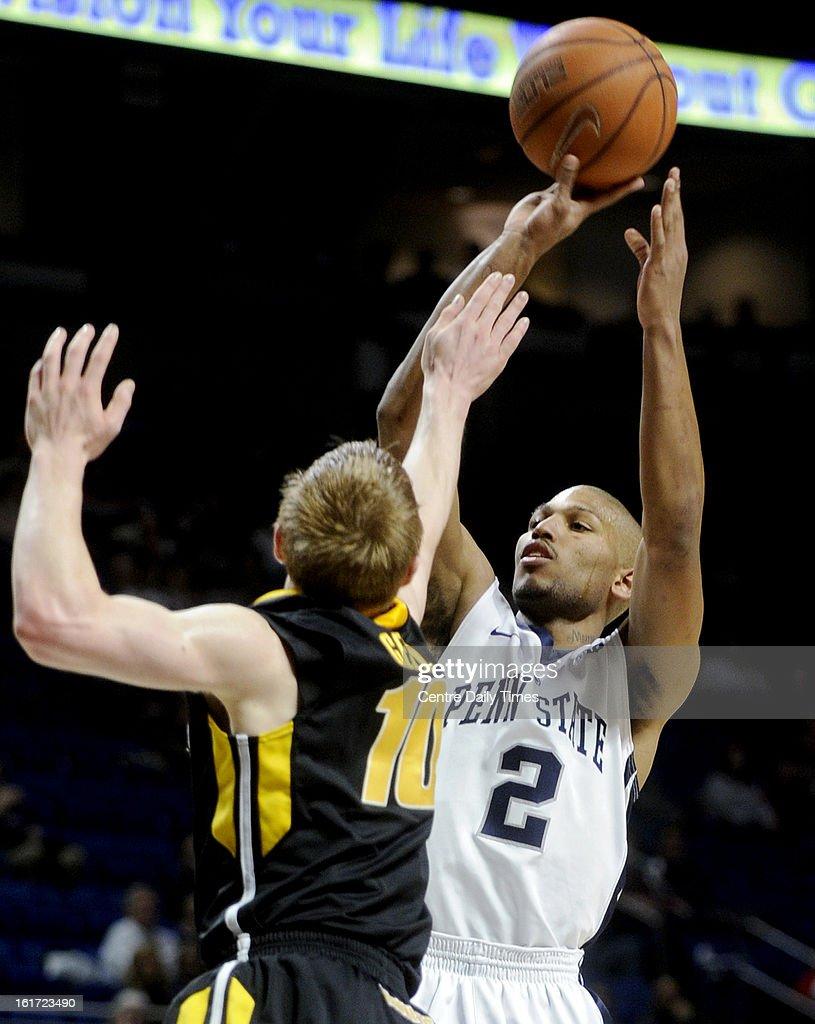 Penn State's D.J. Newbill (2) shoots over Iowa's Mike Gesell at the Bryce Jordan Center in University Park, Pennsylvania, on Thursday, February 14, 2013. Iowa won, 74-72.