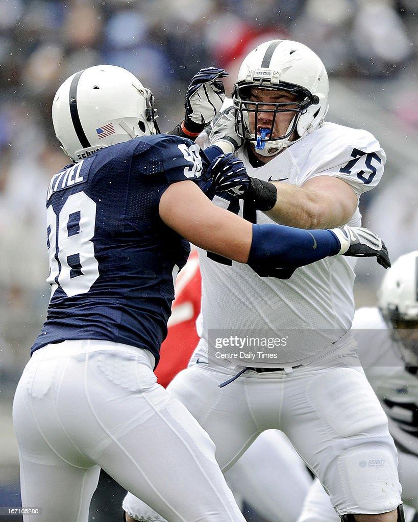 Penn State's Eric Shrive, right, blocks Anthony Zettel during the team's spring scrimmage at Beaver Stadium in University Park, Pennsylvania, on Saturday, April 20, 2013.