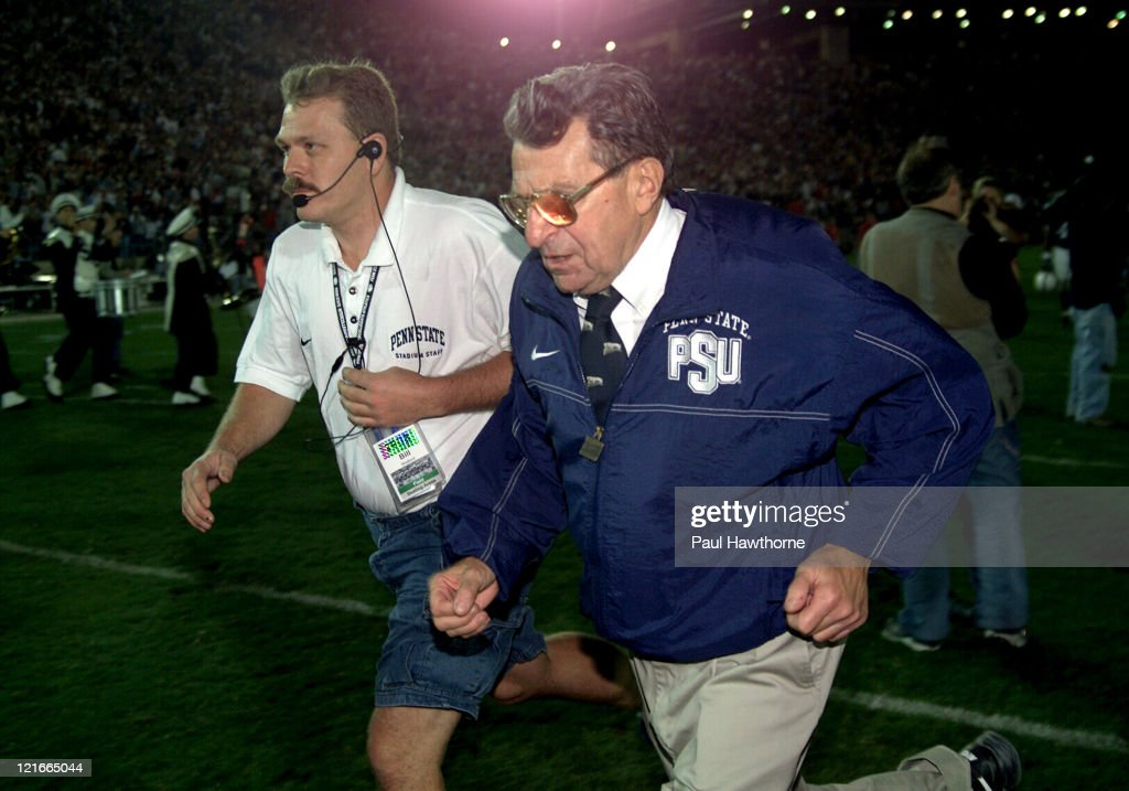 Penn State's Head Coach <a gi-track='captionPersonalityLinkClicked' href=/galleries/search?phrase=Joe+Paterno&family=editorial&specificpeople=623059 ng-click='$event.stopPropagation()'>Joe Paterno</a> runs off the field after Penn States loss to Ohio State at Beaver Stadium in University Park, Pennsylvaina, November 1, 2003. Ohio State won the game 21 - 20