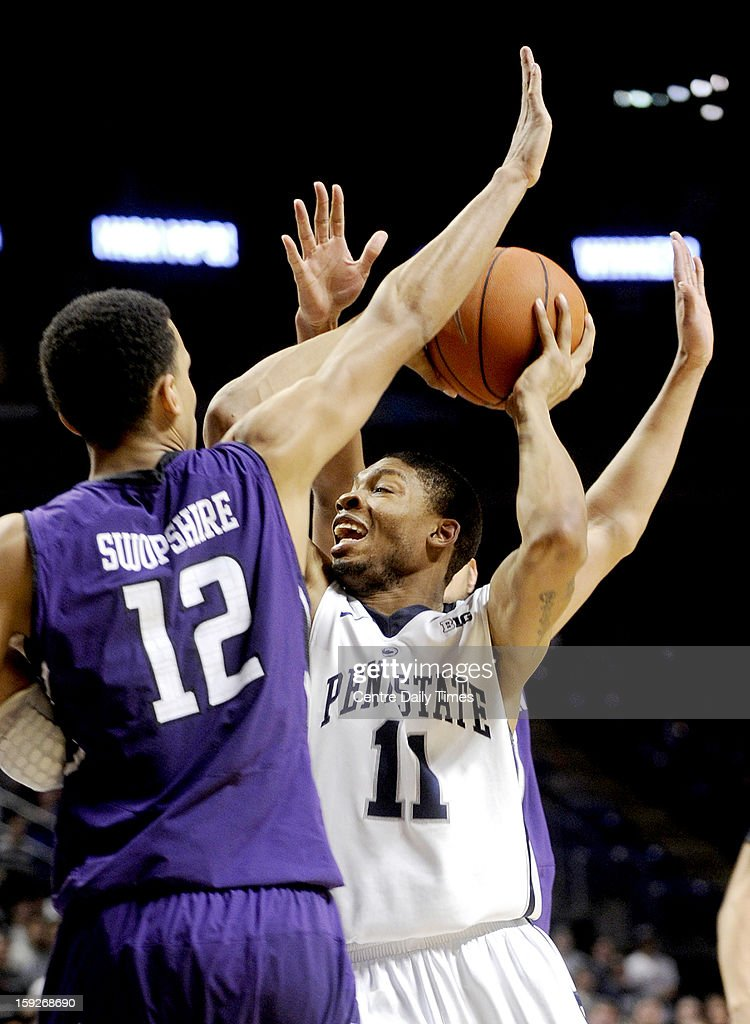 Penn State's Jermaine Marshall (11) looks for a shooting lane around Northwestern's Jared Swopshire at the Bryce Jordan Center in University Park, Pennsylvania, on Thursday, January 10, 2013.