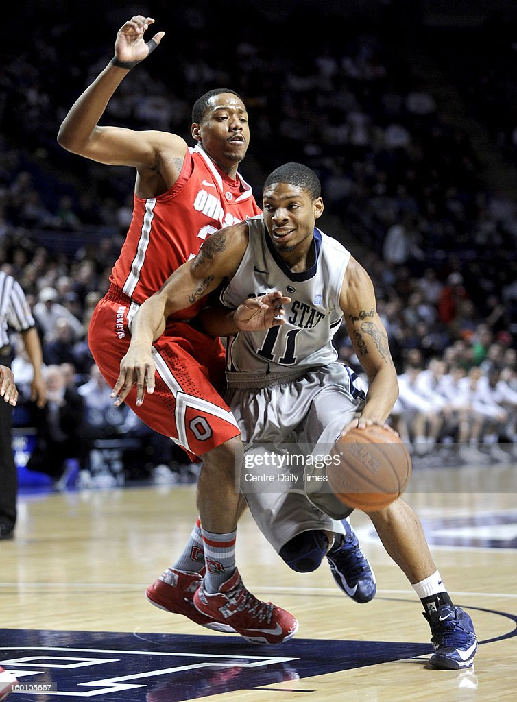 Penn State's Jermaine Marshall, right, drives against Ohio State's Lenzelle Smith Jr. on Saturday, January 26, 2013, at the Bryce Jordan Center in University Park, Pennsylvania. Ohio State won, 65-51.
