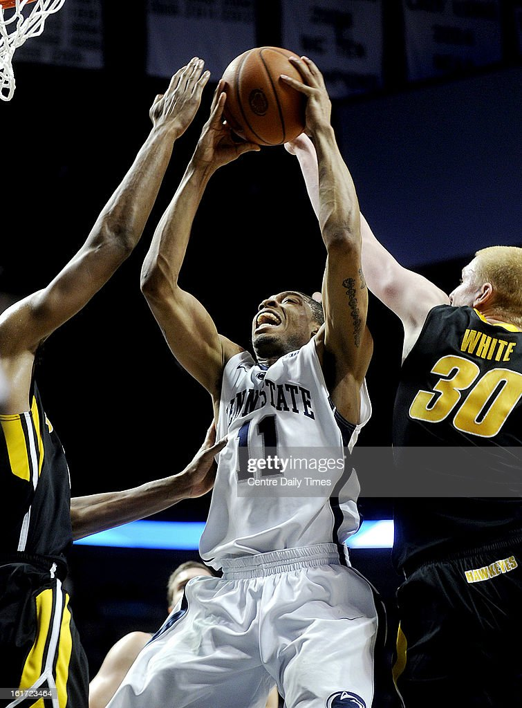 Penn State's Jermaine Marshall (11) tries to shoot in between Iowa defenders at the Bryce Jordan Center in University Park, Pennsylvania, on Thursday, February 14, 2013. Iowa won, 74-72.