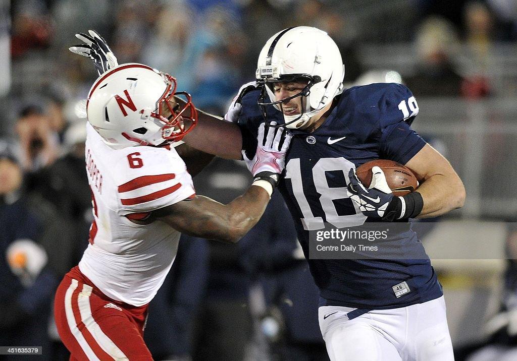 Penn State's Jesse James gets past Nebraska's Corey Cooper for a touchdown at Beaver Stadium in University Park, Pa., on Saturday, Nov. 23, 2013. Nebraska won, 23-20.