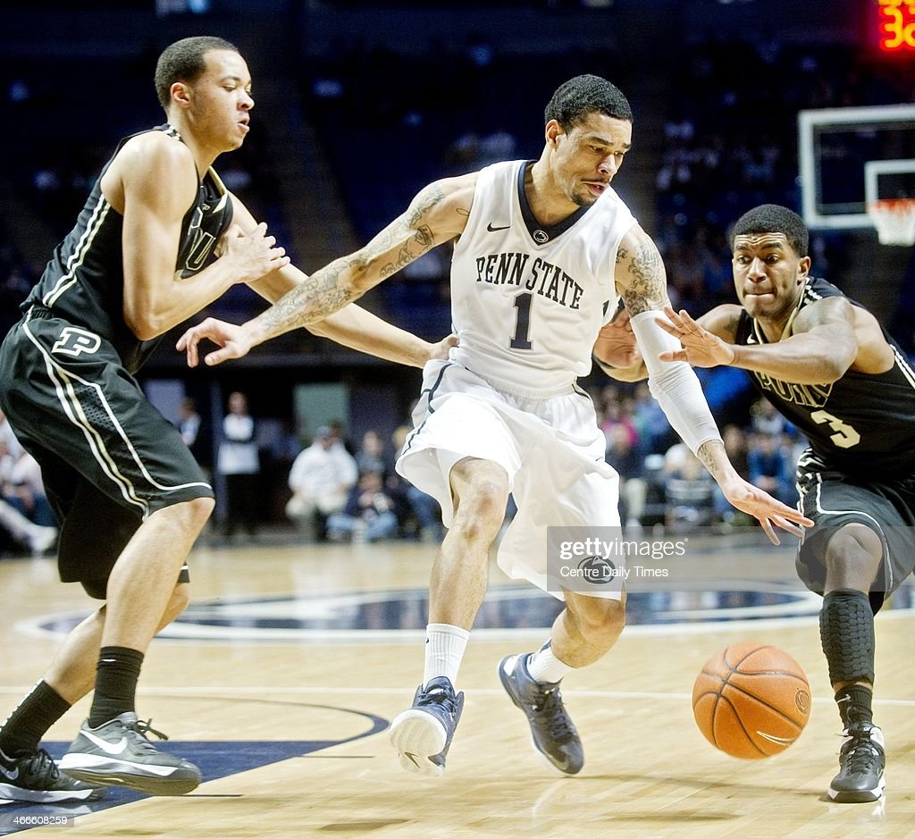 Penn State's John Johnson dribbles down court past Purdue defenders on Sunday, Feb. 2, 2014, at the Bryce Jordan Center in State College, Pa. The Nittany Lions defeated the Boilermakers, 79-68.