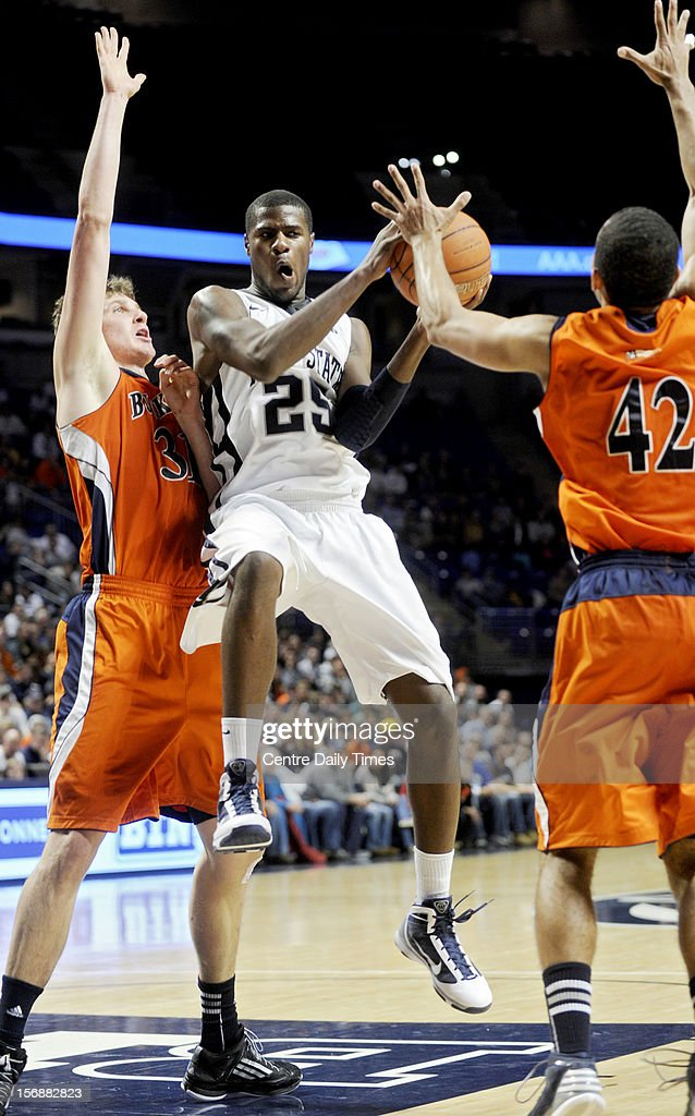 Penn State's Jon Graham (25) looks for an open teammate as he is double-teamed by Bucknell's Mike Muscala and Cameron Ayers (42) on Friday, November 23, 2012, at the Bryce Jordan Centerin University Park, Pennsylvania. Penn State prevailed, 60-57.