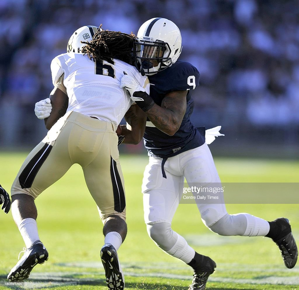 Penn State's Jordan Lucas attempts to stop Central Florida's Rannell Hall on Saturday, September 14, 2013, at Beaver Stadium in University Park, Pennsylvania. UCF prevailed, 34-31.