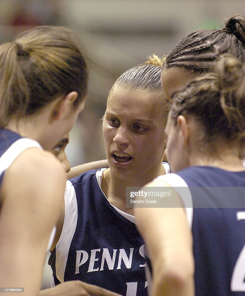 Penn State's Kelly Mazzante (center) and teammates listen as Tanisha Wright sets strategy in the second half of Penn State's win 47-42.