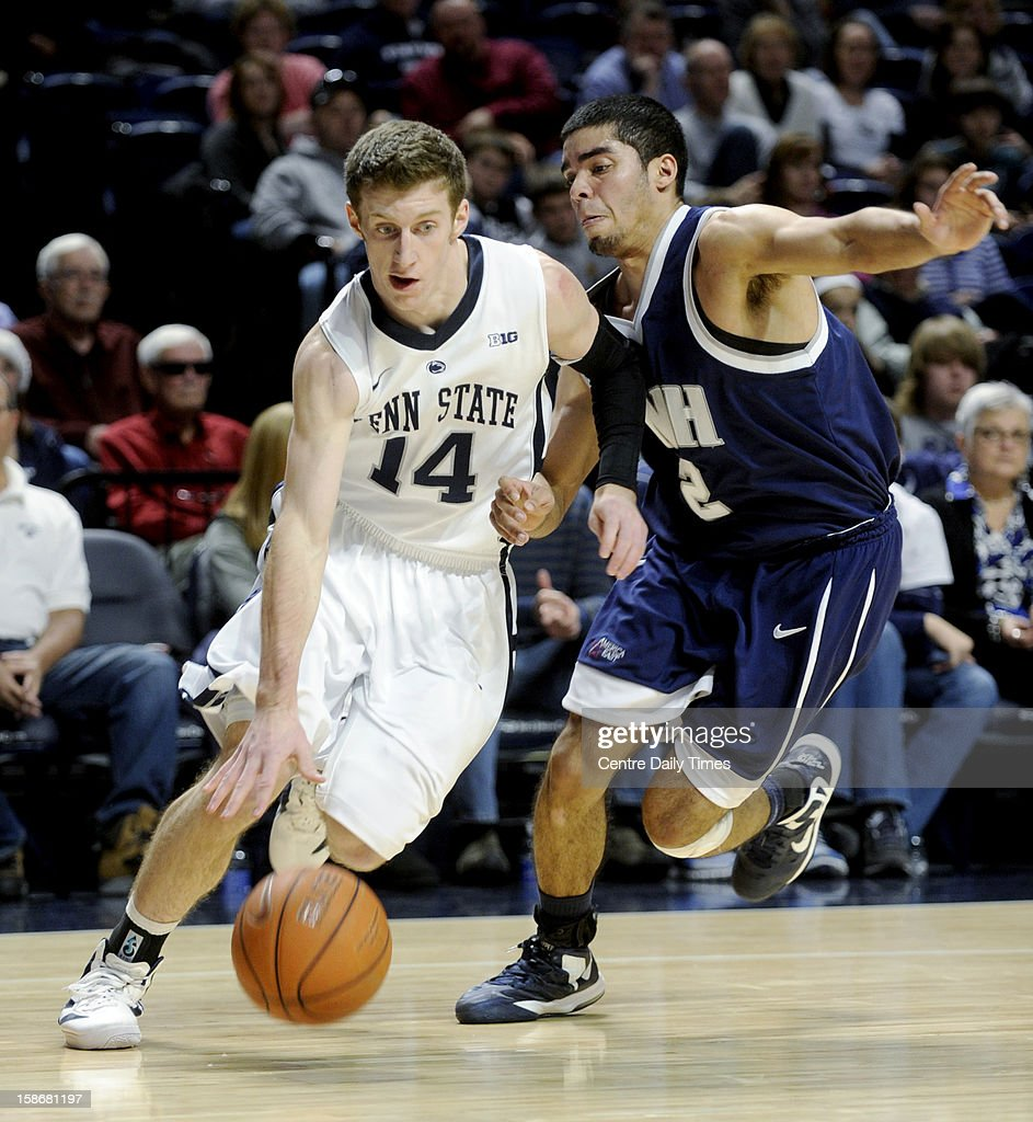 Penn State's Kevin Montminy drives to the basket against the defensive pressure from New Hampshire's Chris Orozco during a men's college basketball game at the Bryce Jordan Center on Sunday, December 23, 2012, in State College, Pennsylvania.