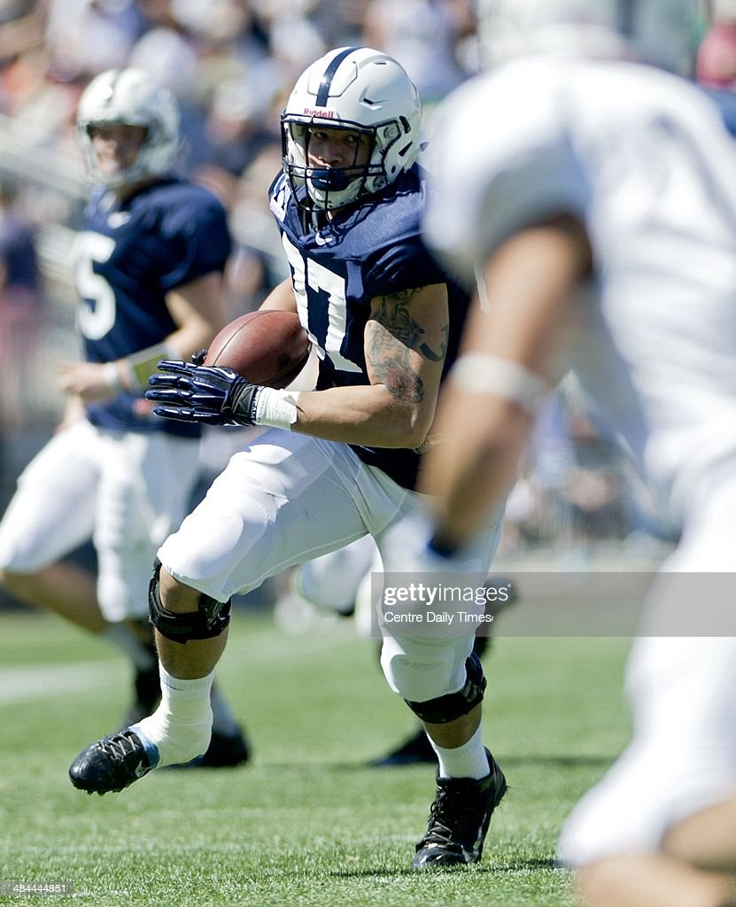 Penn State's Kyle Carter runs down the field with the ball during the Blue-White spring football game on Saturday, April 12, 2014, at Beaver Stadium in University Park, Pa.