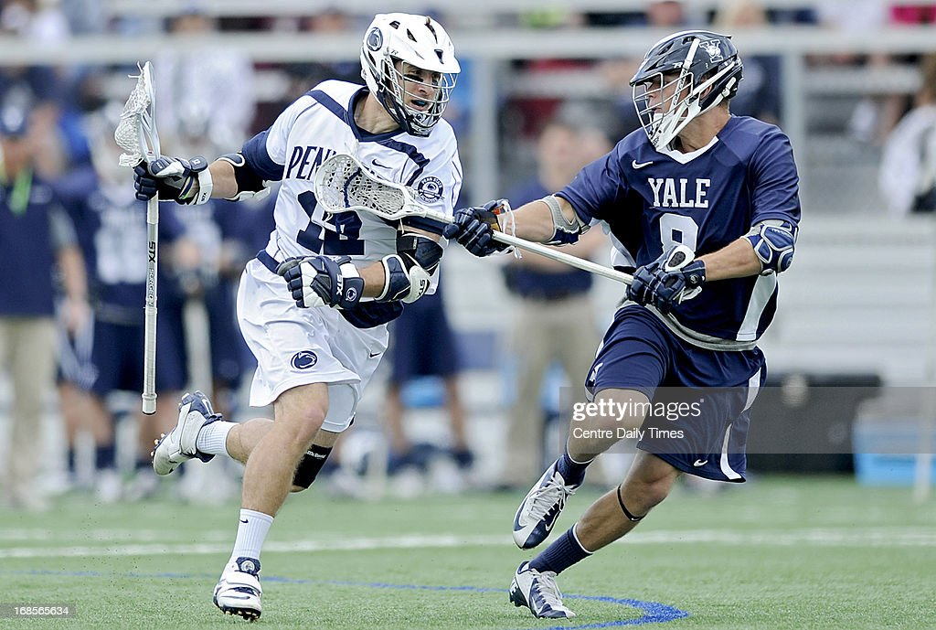 Penn State's Kyle VanThof, left, runs down the field with the ball as Yale's Michael Lipin defends during the first round of the NCAA men's lacrosse tournament in State College, Pennsylvania, Saturday, May 11, 2013.