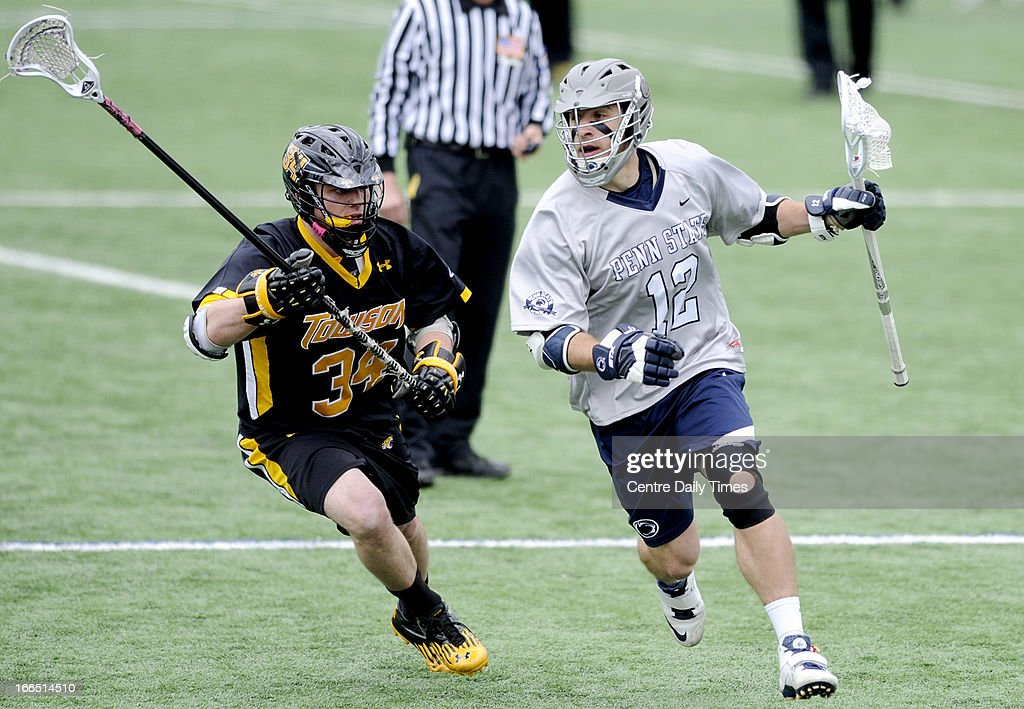 Penn State's Kyle VanThof runs down the field with the ball around Towson's Pat Conroy during the game at University Park in State College, Pennsylvania, Saturday, April 13, 2013. Penn State defeated Towson, 10-8.