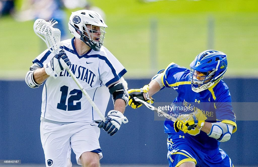 Penn State's Kyle VonThof (12) runs with the ball around Delaware's Chris Colaneri during lacrosse action in State College, Pa., Saturday, April 19, 2014.