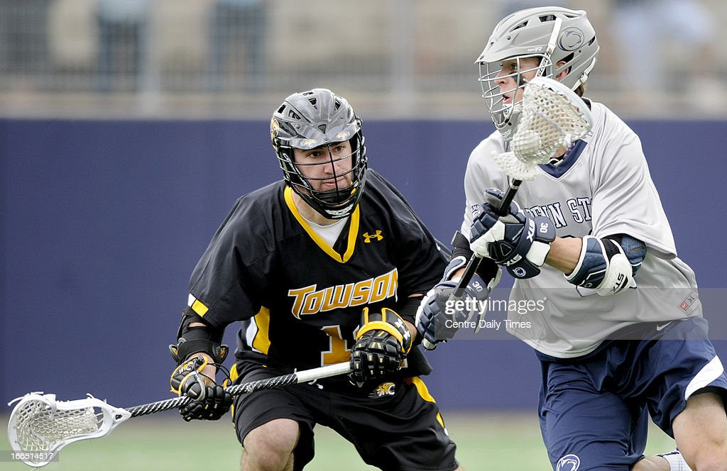 Penn State's Kyle Zittel, right, runs down the field with the ball around Towson's Ben McCarty during the game at University Park in State College, Pennsylvania, Saturday, April 13, 2013. Penn State defeated Towson, 10-8.