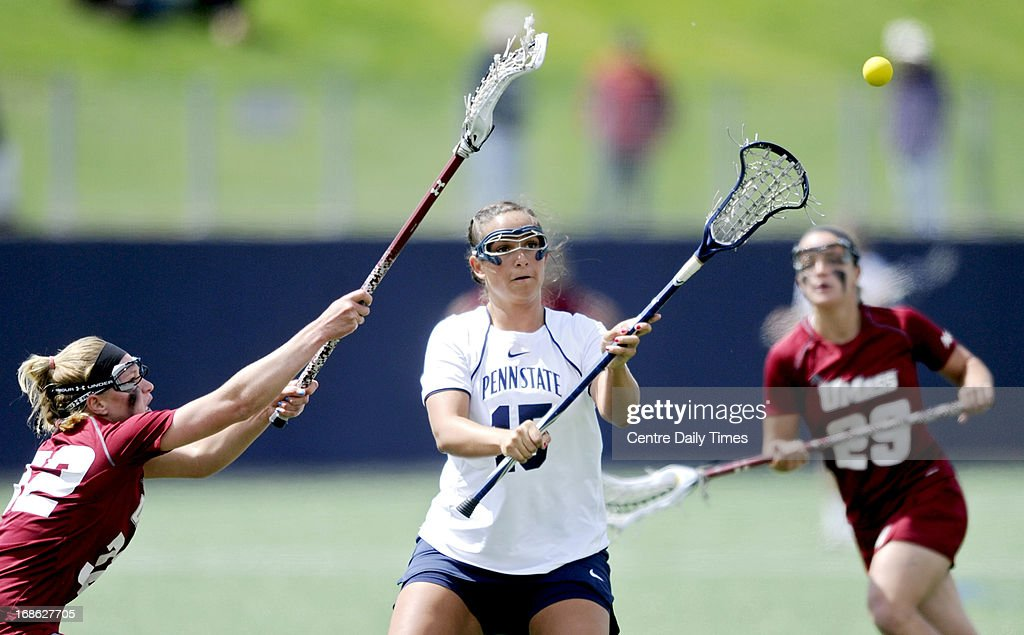 Penn State's Mackenzie Cyr makes a pass past UMass defenders during the second round of the NCAA tournament in State College, Pennsylvania, Sunday, May 12, 2013. Penn State won, 12-9 to advance in the tournament.