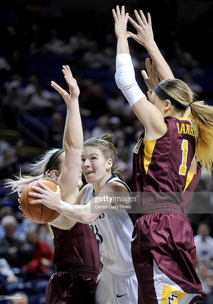 Penn State's Maggie Lucas cuts between two Minnesota defenders on Thursday, January 24, 2013, at the Bryce Jordan Center in University Park, Pennsylvania. The Lady Lions won, 64-59.
