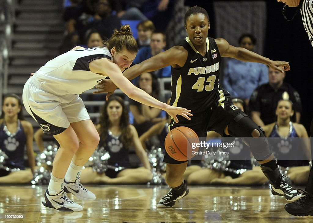 Penn State's Maggie Lucas deflects the ball from Purdue's Chantel Poston during a women's college basketball game in State College, Pennsylvania, Monday, February 4, 2013.