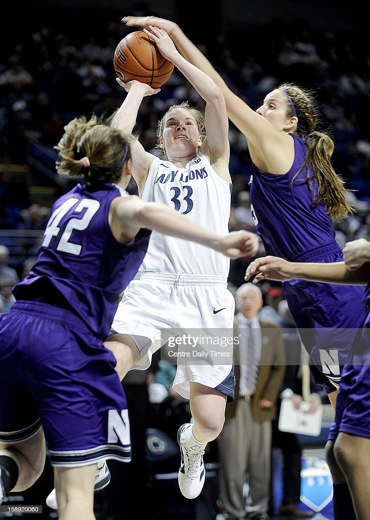 Penn State's Maggie Lucas draws a foul on a drive against Northwestern at Bryce Jordan Center in University Park, Pennsylvania, on Thursday, January 3, 2013. The Lady Lions defeated Northwestern, 73-69.