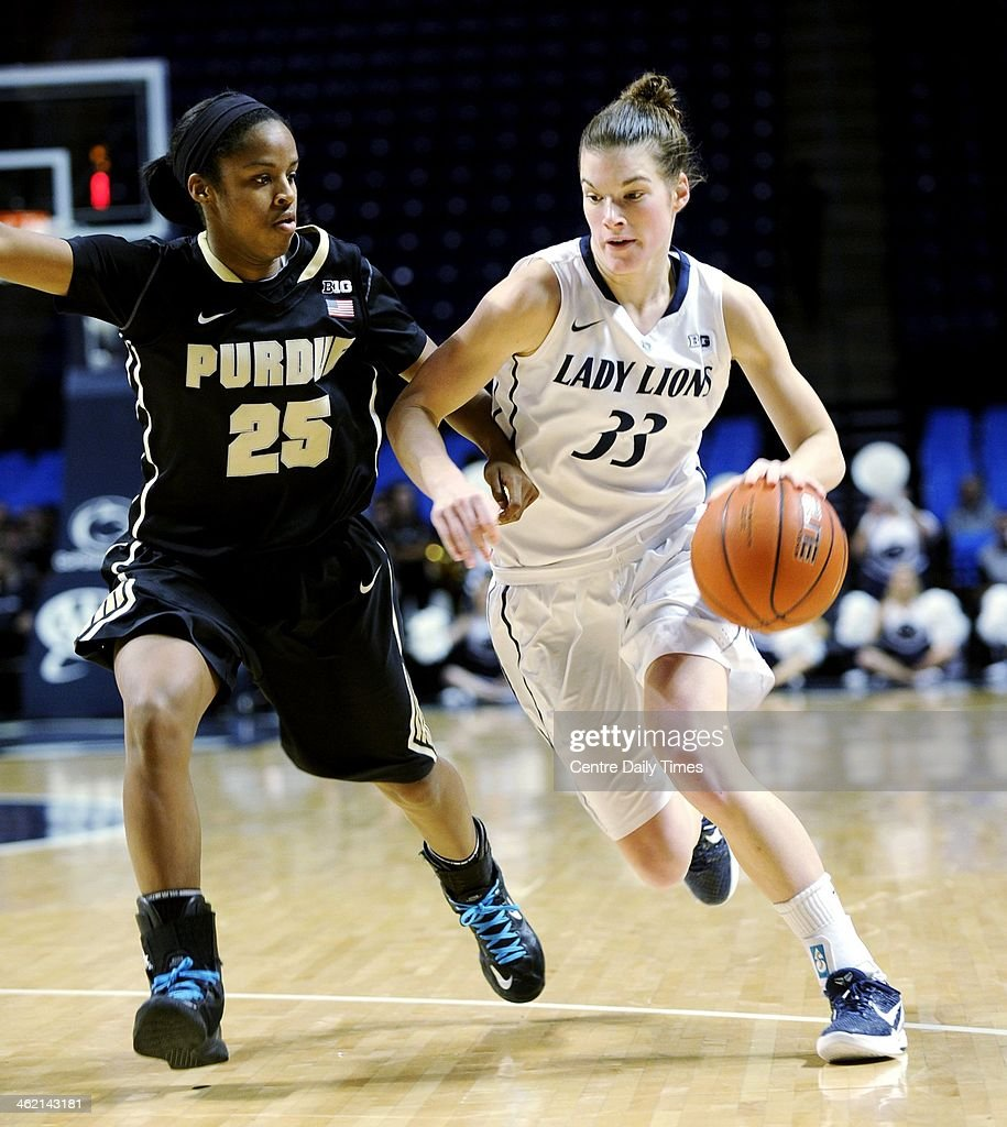 Penn State's Maggie Lucas dribbles down the court with the ball around Purdue's April Wilson at the Bryce Jordan Center in State College, Pa., on Sunday, Jan. 12, 2014.