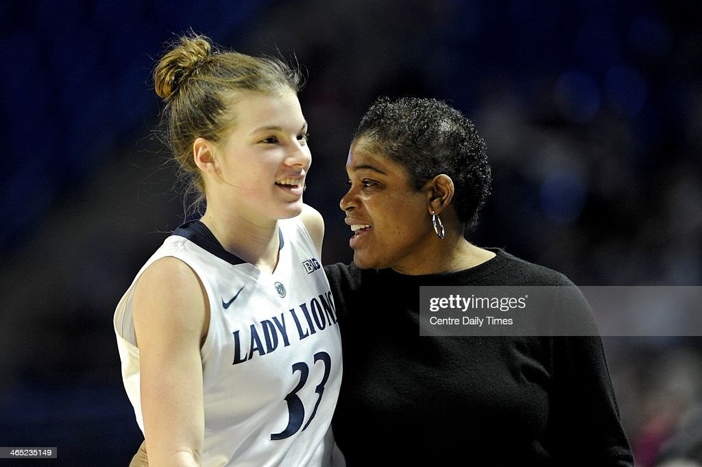 Penn State's Maggie Lucas laughs with coach Coquese Washington between plays at the Bryce Jordan Center in State College, Pa., on Sunday, Jan. 26, 2014. The Penn State Lady Lions defeated the Minnesota Gophers, 83-53.