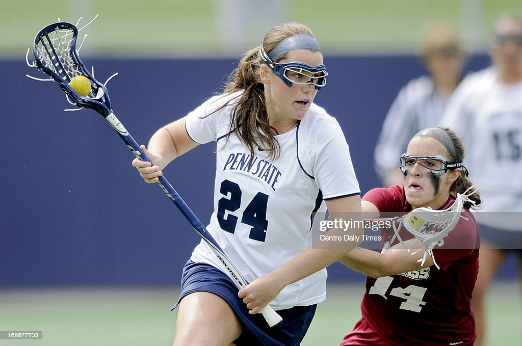 Penn State's Maggie McCormick runs down the field with the ball past UMass' Kate Farnham during the second round of the NCAA tournament in State College, Pennsylvania, Sunday, May 12, 2013. Penn State won, 12-9 to advance in the tournament.