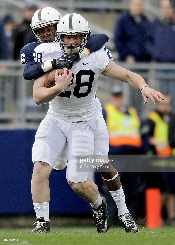 Penn State's Malik Golden tackles Zach Zwinak from behind during the team's spring scrimmage at Beaver Stadium in University Park, Pennsylvania, on Saturday, April 20, 2013.